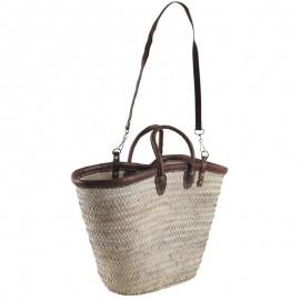 Cabas en palmier. Bord, bandoulières et poignées en cuir.